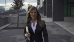 SLOW MOTION: Businesswoman walking towards camera Stock Footage
