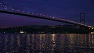 Istanbul night city and bosporus bridge Stock Footage