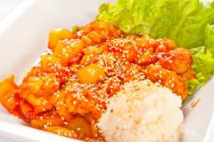 Stock Photo of meat with vegetables and rice in sweet-sour sauce