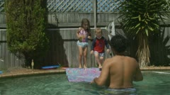 Father playing with his children in swimming pool (6) model release Stock Footage