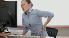 Young business woman with back pain HD - stock footage