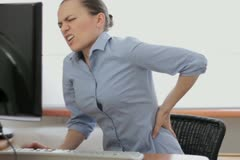 Young business woman with back pain NTSC Stock Footage