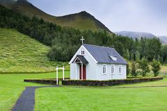 typical rural icelandic church at overcast day - stock photo