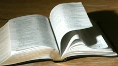 Bible pages turning in the wind Stock Footage