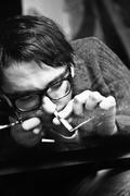 young man in glasses inhaling drugs - stock photo