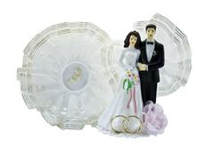 Figures of a newly-married couple Stock Photos