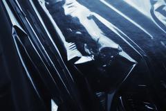 Texture glossy black cellophane Stock Photos
