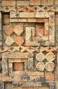 Ancient mexican designs and symbols on the pyramids of the maya of yucatan Stock Photos