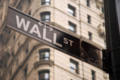 Wall street sign in New York city close-up view Stock Photos