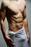 Young macho man using white towel Stock Photos