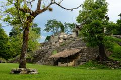 Girl explores archaeological structure in the ancient mayan city of palenque, Stock Photos