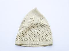 gray thread knitted  hat isolated on white background - stock photo