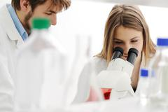 Young science workers research at medical lab Stock Photos