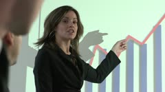 Business woman explaining company's profits using graph - stock footage