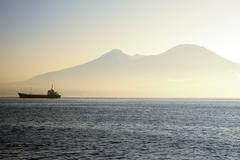 Ferry on a sea with Mount Vesuvius in background Stock Photos