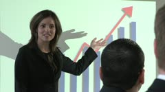 Business woman happily presenting the company's profit to team - stock footage