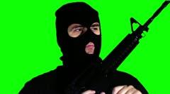 Man with Gun Reloading Closeup Greenscreen 60 720 - stock footage