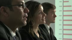 Business team listening and responding to boss off camera - stock footage