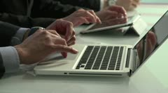 Close up of business employees' hands using laptops and tablets Stock Footage