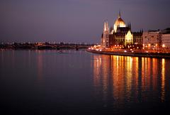 Illuminated Parliament building in Budapest at night Stock Photos