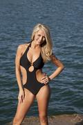 woman black swim suit smile - stock photo