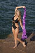 woman black swim suit purple sarong - stock photo
