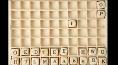 Business buzz words spelled out in dice and placed on grid Stock Footage