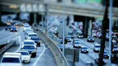Tilt Shift Time Lapse of Highway Traffic Downtown Los Angeles - stock footage