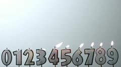 Number candles blowing out in numerical order with copy space Stock Footage