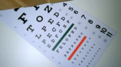 Blocks spelling out sight falling onto eye test Stock Footage