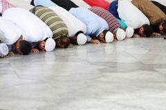 muslims praying together at holy mosque - stock photo