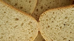 Bread slices rotating on a plate. Stock Footage
