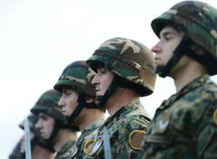 Stock Photo of soldiers with military camouflage uniform in army formation