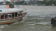 A River Taxi Approaches Saphan Taksin Pier p64 Stock Footage