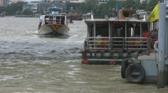 Tourist Boats Pass at Saphan Taksin Pier p71 Stock Footage