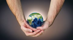 Earth spinning in mans hands Stock Footage