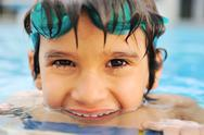 Stock Photo of kid having happy time in the pool water