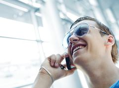 young man using cell phone - stock photo