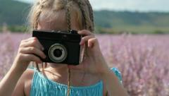 Child with camera Stock Footage
