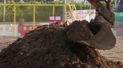 Digger dumping soil in a truck Stock Footage