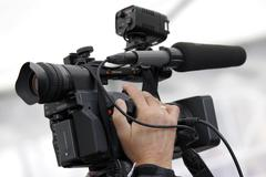Cameraman and video camera Stock Photos
