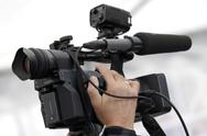 Stock Photo of Cameraman and video camera