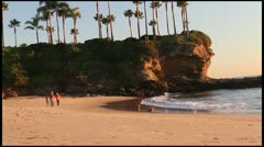 Kids Running down the Beach at Sunset - stock footage