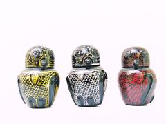 the colorful artistic lacquerwear owls isolated on white. - stock photo
