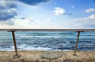 Stock Photo of sea behind banister