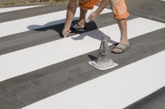 crosswalk repairing - stock photo