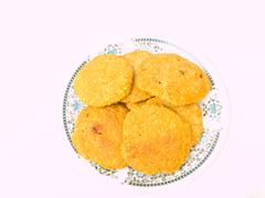 pile of cookies on a chiness porcelane plate isolated on white background - stock photo