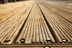 diminishing wooden deck - stock photo
