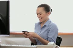 Young business woman using cell phone in the office NTSC - stock footage