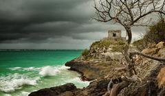 panoramic view of the old watchtower in the ancient city of tulum on the cari - stock photo